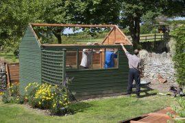 3 men dismantling a shed