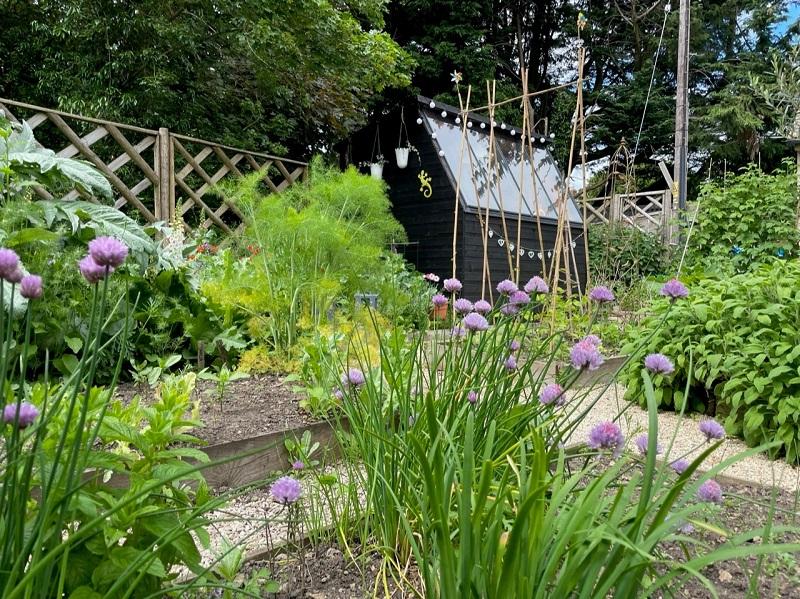 Potting Shed in a flower-filled garden