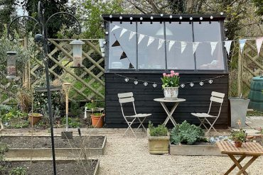Front of a Tiger Potting Shed in a garden