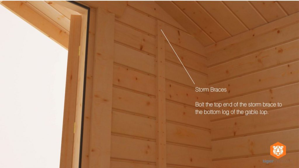 Storm braces installed in a log cabin