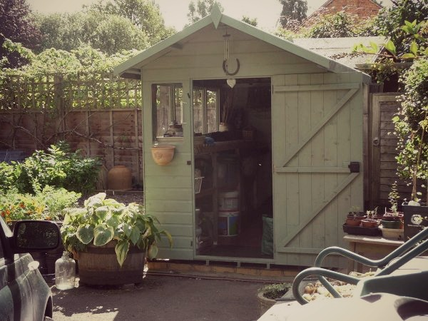 This customer has created an authentic and raw look by painting his shed a light green to match his green garden.
