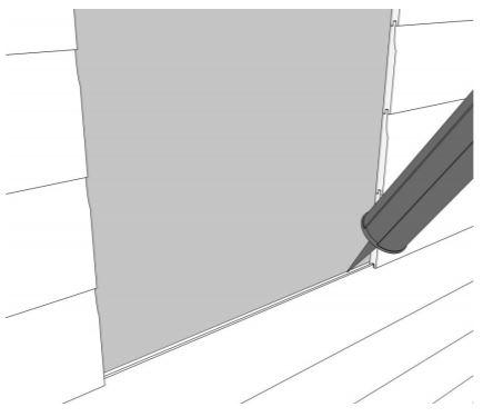 An image showing a sealant gun sealing a window