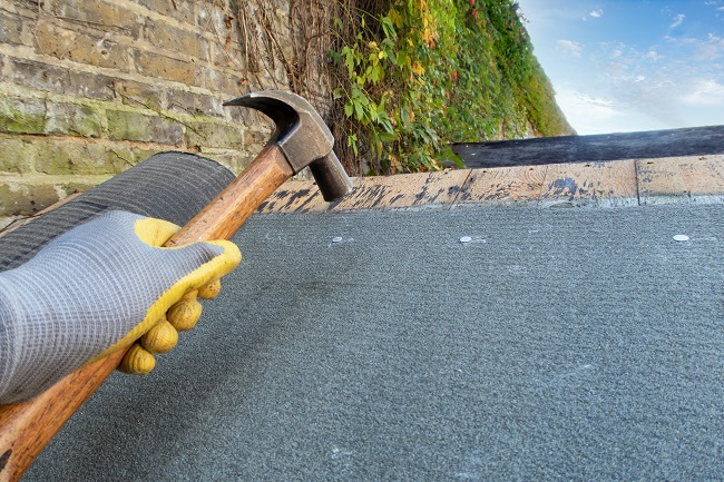 Laying shed roofing felt - repairs
