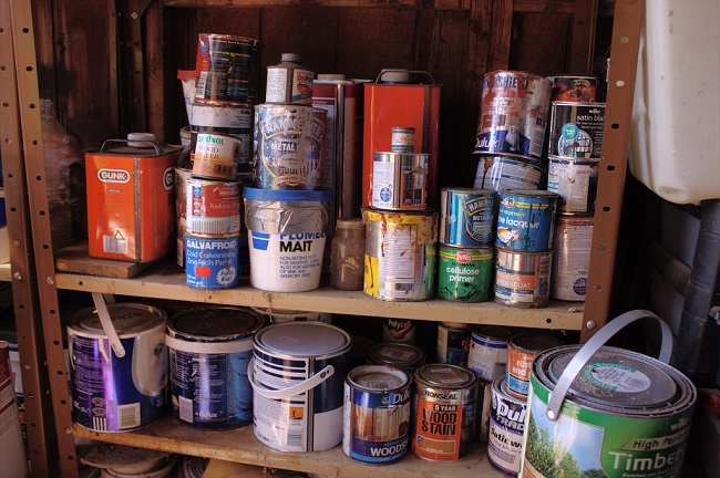 Paint cans left in a shed