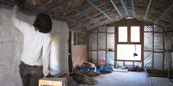 Man installing rockwool insulation