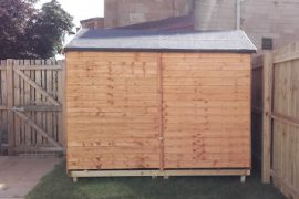 Shed next to fence