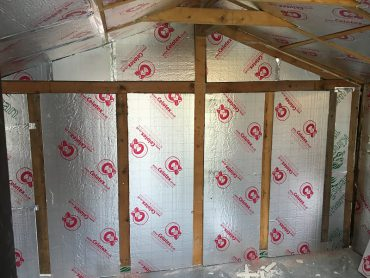 Freshly installed shed wall insulation
